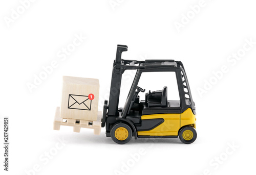 Yellow forklift with new email graphic on wooden block over white background