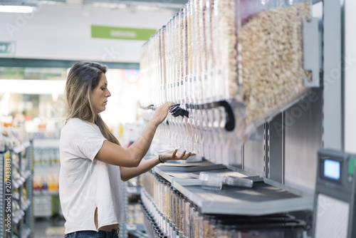 Fotografie, Obraz  A women buying cereals in the supermarket