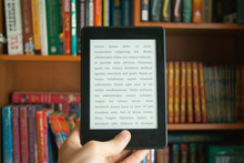 E-book In Man's Hand With Lore...
