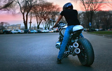 City Biker Rides His Motorcycle In The Evening