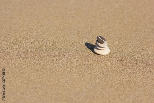 Foto op Plexiglas Stenen in het Zand Balanced several Zen stones on the beach background