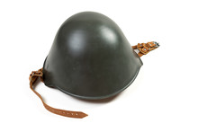 East German M56/76 Stahlhelm, Or Steel Helmet, Military Surplus Items Circa 1970s-1980s Isolated On A White Background, From The National People's Army