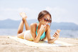 girl with smartphone on a beach