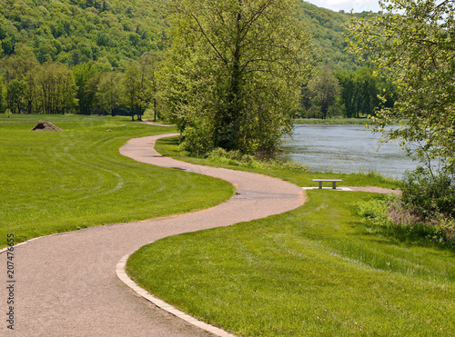 A walkway in a park along the Allegheny River in Tionesta, Pennsylvania Canvas Print