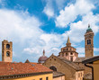 Buildings and roofs of main sightseeing spots of upper town of Bergamo, Italy. Basilica of Santa Maria Maggiore,Cappella Colleoni, Cathedral and Campanone tower.