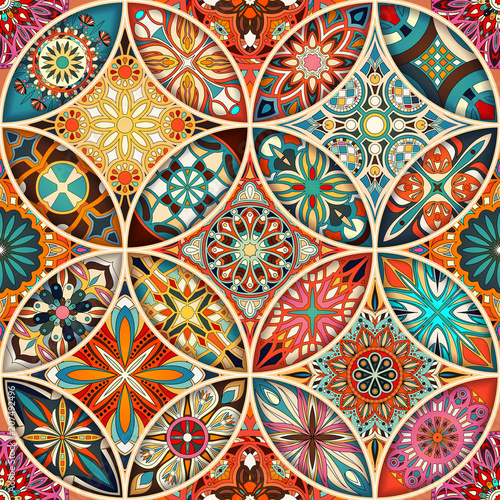 Seamless pattern with decorative mandalas. Vintage mandala elements.