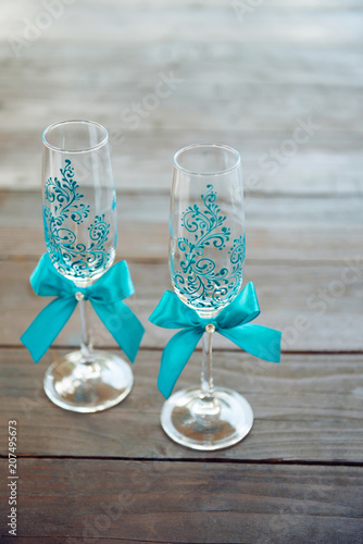 Festively decorated wine glasses for the wedding ceremony. Wedding decor