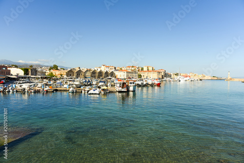 In de dag Poort View of the Venetian port of Chania with the ancient venetian shipyards and center of mediterranean architecture