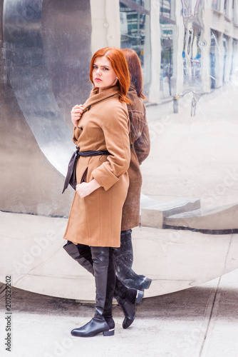 Young American Woman Wearing Long Brown Woolen Overcoat With Belt