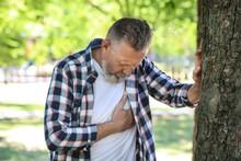 Mature Man Having Heart Attack In Park