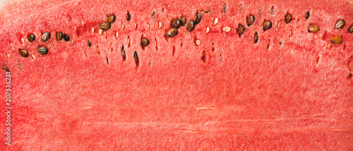 Juicy ripe watermelon texture. Ripe juicy summer fruit watermelon texture, wallpaper and background, top view.