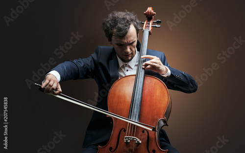 Lonely cellist composing on cello with nothing around Fotobehang