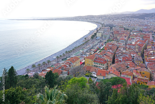 Deurstickers Toscane Landscape view at sunset of the Promenade des Anglais along the Mediterranean Sea in Nice, French Riviera, France seen from the Colline du Chateau.