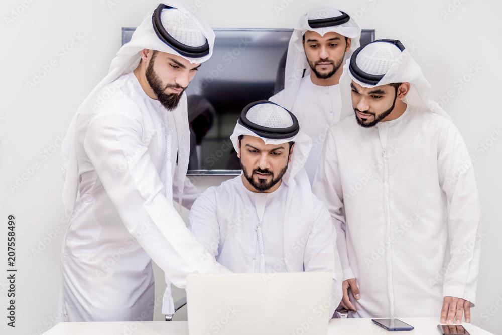 Fototapeta Group of businessmen in Dubai