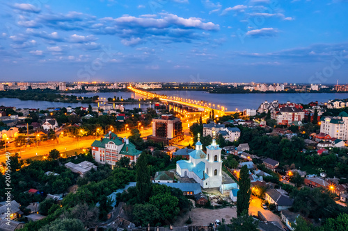 Foto op Aluminium Oude gebouw Night summer Voronezh. View to the road to Chernavsky Bridge, river and Tikhvin-Onufrievsky church