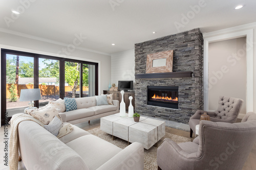 Adobe Stock & Beautiful Living Room Interior in New Home with Fireplace ...