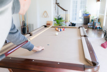 Interior Inside House Home With Billiard Pool Table In Living Room, Man In Winter Cold Sweater Shooting White Ball During Game Start With Cue