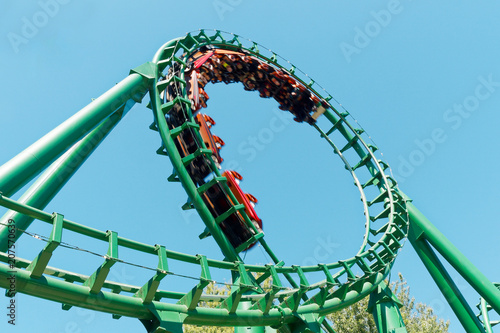Photo sur Toile Attraction parc Loop rollercoaster fun ride at amusement park