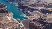 The Hoover Dam, Between Nevada...