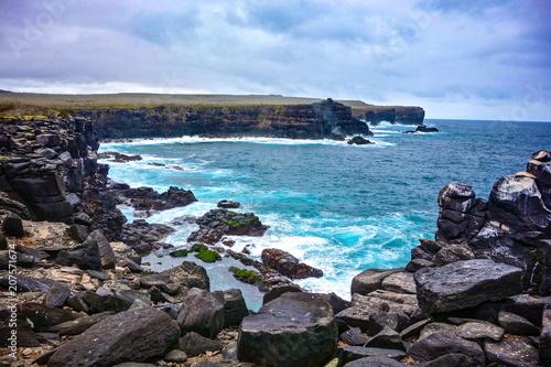 Fotografie, Obraz  Volcanic rock along the coastline of Suarez Point, Espanola, in the Galapagos Is