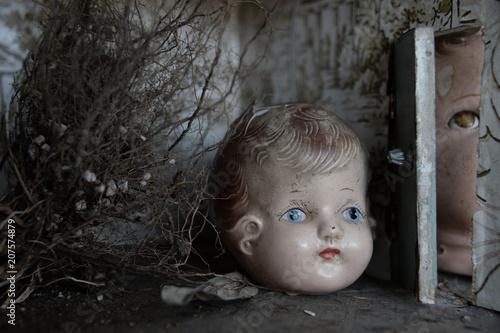 Photo  dolls heads in dollhouse