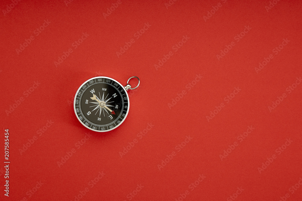 Fototapety, obrazy: compass on red background top view