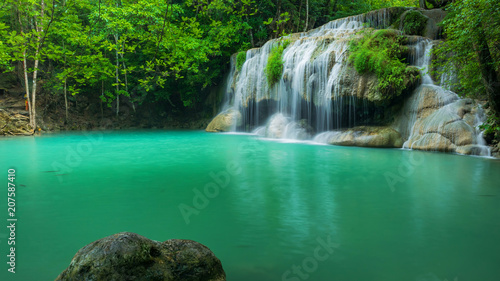 Poster Watervallen Breathtaking green waterfall at tropical rain forest, Erawan waterfall located Kanchanaburi Province, Thailand