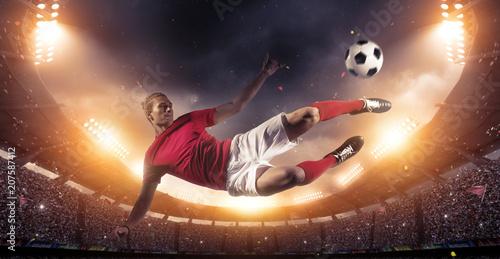 Obraz na płótnie Soccer player in action on stadium background.
