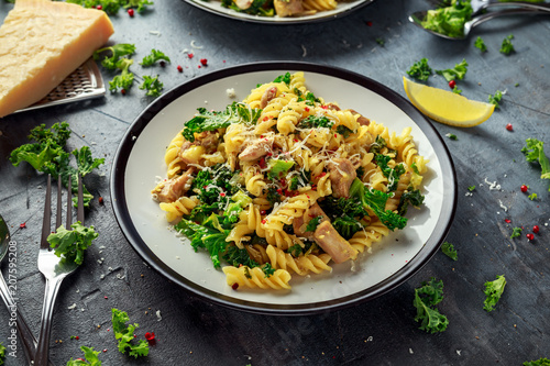 Fotoposter Klaar gerecht Homemade Pasta fusilli with Chicken, Green Kale, Garlic, lemon and parmesan cheese. healthy home food
