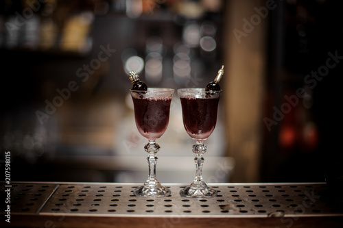 Two elegant glasses filled with sweet and strong Arnaud cocktail Wallpaper Mural