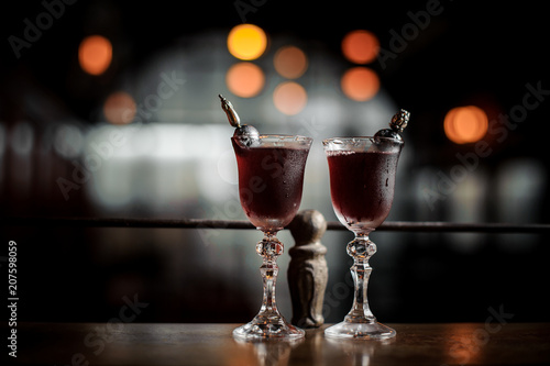 Two elegant glasses filled with fresh sweet and strong summer Arnaud cocktail on Wallpaper Mural