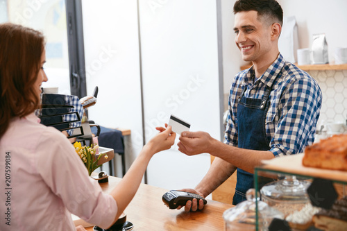 Buy Coffee. Woman Paying With Credit Card In Cafe