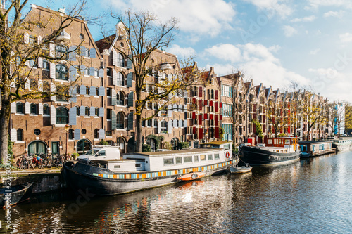 Fotobehang Praag Beautiful Architecture Of Dutch Houses and Houseboats On Amsterdam Canal In Autumn
