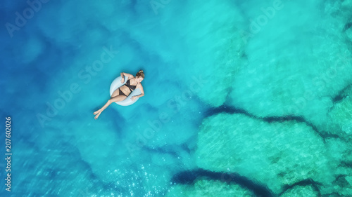 Spoed Foto op Canvas Groene koraal Aerial view at the girl on sea surface. Beautiful composition at the summer time