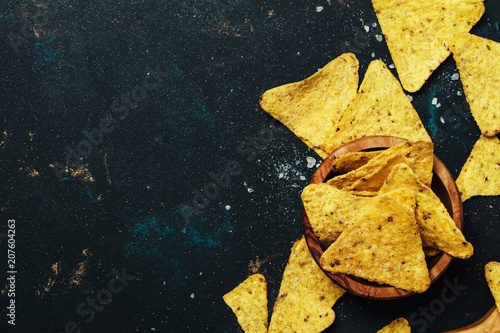 Cuadros en Lienzo Salted Mexican Corn Nachos iIn Wooden Bowl, Black Background, Top View