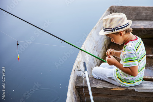 Young fisherman catching fish on fish-rod