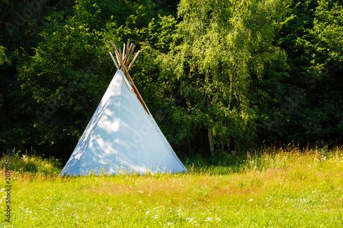 Keuken foto achterwand Historisch geb. white teepee indian tent standing in beautiful summer landscape.