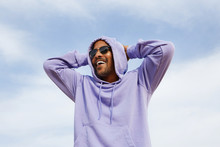 Summer Active Sports Concept. Smiling Happy Young African-American Man Hipster In Sport Hoody And Sun Glasses On The Beach