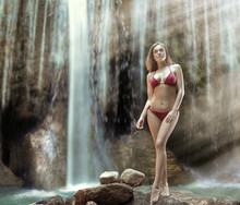 Sensual Blonde Woman Posing Over The Waterfall