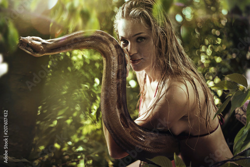 Fotobehang Artist KB Portrait of a pretty blonde holding a wild snake