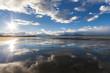 Reflection of sky in sandy beach of Alaska. Near Homer.