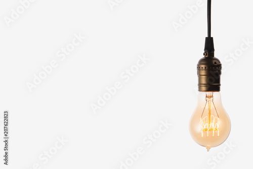 Photo  Edison light bulb on white background. space for text