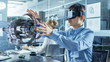 canvas print picture - Computer Science Engineer wearing Virtual Reality Headset Works with 3D Model Hologram Visualization, Makes Gestures. In the Background Engineering Bureau with Busy Coworkers.