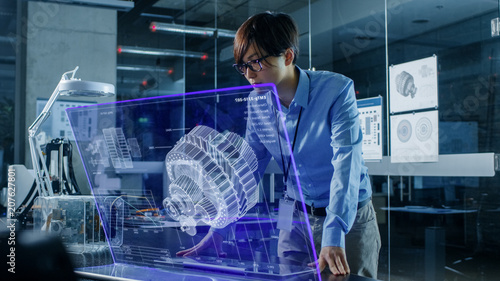 Photo  Asian Neural Network Engineer Uses Modern Computer With Transparent Holographic Display