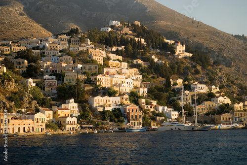 Foto  Simi Island, houses and harbor, Greece.