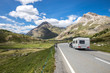RV road trip in the swiss mountains. Caravan on the road.