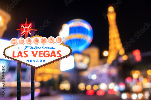 Famous Las Vegas sign with blur cityscape Canvas Print