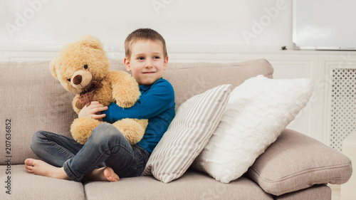 Little cute child with Teddy bear at living room #207636852