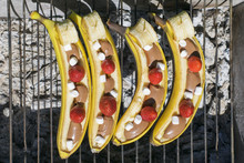 Fresh Bananas With Seasonal Strawberries, Chocolate And Marshmallow Are Cooked On The Grill.Idea Picnic.Top View