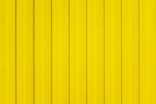 A Corrugated Fence Of Yellow M...
